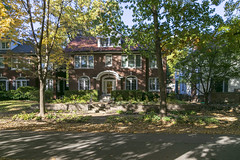 House — University City, Missouri (Pythaglio) Tags: house dwelling residence historic brick twostory eclectic threebay segmentalarched windows doorway fanlight arched hedges shrubbery steps retainingwall street trees shadows universitycity missouri saintlouiscounty stlouiscounty