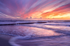 Objects in Motion (b.adolphi) Tags: sea sunset beach colorful water sand sky sun markgrafenheide mecklenburgvorpommern germany ocean balticsea purple magenta orange red yellow