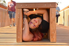 Managing to hide anywhere (radargeek) Tags: twistina christina scissortailpark contortion contortionist bendy bendythings chucks converse redhair okc oklahomacity downtown bench