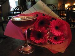 Lisa's Leisure Champagne Cocktail (raaen99) Tags: cocktail alcohol champagne champagnecocktail lisasleisure blackberryliquor cherryliquor frenchchampagne glass champagneglass champagneflute flute marieantoinetteglass marieantoinettechampagneglass marieantoinettechampagneflute bar cocktailbar cabinetbar cabinetcocktailbar bubbles pink magenta gerbera happyflower flower floral bloom petal bouquet wrap wrapping chair seat table melbourne victoria australia melbournecbd cbd centralmelbourne swanstonstreet swanstonst thonetbentwoodchair thonetchair beverage alcoholicbeverage celebration drink evening indoors inside bentwoodchair