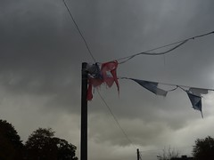 The ragged end of the season (Phil Gayton) Tags: bunting flag silhouette sky cloud riverside cafe steamer quay totnes devon uk