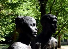Statue of a couple, Yoyogi Park, Tokyo, Japan (MJ Reilly) Tags: tokyo japan statue yoyogi yoyogipark sun trees japanese art park