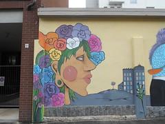 417 (en-ri) Tags: liceo artistico cottini ragazza girl fiori flowers giallo marrone rosa verde torino wall muro graffiti writing azzurro grattacieli
