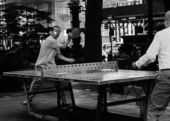 Bryant Park (D80_546428) (Itzick) Tags: manhattansep2019 bryantpark nyc pingpong streetphotography bw men candid d800 itzick