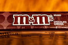 mmm M&Ms HMM :-) (Dotsy McCurly) Tags: macromondays brandandlogos hmm happymacromonday mms box candy graphic macro canoneos80d efs35mmf28macroisstm