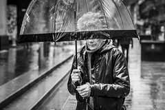 Shelter (Leanne Boulton) Tags: urban street candid portrait portraiture streetphotography candidstreetphotography candidportrait streetportrait streetlife anonymous woman lady female face expression mood emotion rain raining weather wet umbrella autumn shower tone texture detail depthoffield bokeh naturallight outdoor light shade city scene human life living humanity society culture lifestyle people canon canon5dmkiii 70mm ef2470mmf28liiusm black white blackwhite bw mono blackandwhite monochrome glasgow scotland uk