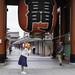 Visitor wearing Magikarp hat at the south face of the Kaminarimon at Sensō-ji Buddhist Temple in Tokyo, Japan