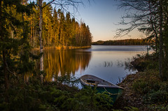 Morning light II (mabuli90) Tags: finland lake water boat autumn fall morning sunrise tree forest longexposure reflection