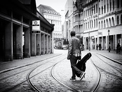 the guitarist (Sandy...J) Tags: atmosphere blackwhite bw augsburg city cobblestones monochrom man mood street streetphotography sw schwarzweis strasenfotografie stadt stimmung urban noir germany deutschland fotografie photography lines linien mann olympus