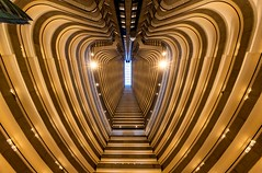 Heart of the City (Karen_Chappell) Tags: travel atlanta usa hotel up perspective gold golden layers levels balconies architecture curves lines abstract building georgia city urban shapes colour color colourful fisheye wideangle canonef815mmf4lfisheyeusm geometry geometric