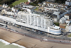 Inspired by the RMS Queen Mary, completed in 1938, it was the tallest block of flats in the UK - Marine Court in Hastings - East Sussex UK aerial image (John D Fielding) Tags: stleonardsonsea hastings sussex eastsussex artdeco grade2 listed southcoastpropertiescompany above aerial nikon d810 hires highresolution hirez highdefinition hidef britainfromtheair britainfromabove skyview aerialimage aerialphotography aerialimagesuk aerialview viewfromplane aerialengland britain johnfieldingaerialimages fullformat johnfieldingaerialimage johnfielding fromtheair fromthesky flyingover fullframe cidessus antenne hauterésolution hautedéfinition vueaérienne imageaérienne photographieaérienne drone vuedavion delair birdseyeview coast coastline coastal beach seaside flats residential