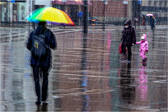 Back To The Rain (Fermat 48) Tags: umbrella fedup stpeterssquare manchester central library colourful torrential rain wet water reflection canon eos 7dmarkii
