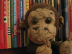A Well Loved Companion (raaen99) Tags: freestyleonthefifth fotf fff flickrfamousfive beautyindecay beauty decay decaying old chippy monkey chippythemonkey chippymonkey softtoy vintage toy vintagemonkey vintagetoy machinemade 1950s patch patches handsewn repairs repaired glasseyes eye book books library childrensbooks bookshelf softie plush cute cuddly soft