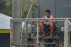 On the Steps (risingthermals) Tags: philippines pilipinas filipinos pilipinos pinoys humans humanity candid street photography tropical country southeast asians everyday life scenes capture events experiences unposed natural people man cellphone smartphone sitting down steps stairs fence glasses