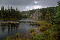 Rain Falling on the Waters of Horseshoe Lake (Denali National Park & Preserve) (thor_mark ) Tags: nikond800e alaska2019 day4 denalinationalparkpreserve denalinationalparkandpreserve lookingssw azimuth209 dxophotolab2edited imagecapturewitharsenal witharsenal colorefexpro dxophotolab3edited nature outside landscape cloudy overcast mostlycloudy rainyday lightdrizzle trees hillsideoftrees rollinghillsides meadows grassymarsh grassyarea grassyfield grassymeadow evergreentrees evergreens horseshoelake lake pond alonglakeshore alaskayukonranges alaskarange westcentralalaskarange mountains mountainsindistance mountainsoffindistance mountainside ridge ridges ridgeline treereflections treereflectionsonwater glasslikereflections lakereflectionsonwater reflections reflectionsonlake reflectionsonpond reflectionsonwater waterreflections horseshoelaketrail alaska unitedstates portfolio project365