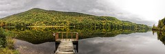 Early Autumn Reflections (Wes Iversen) Tags: americanflags greenmountains nikkor24120mm texturaltuesday vermont flags mountains nature pano panorama piers reflections texture trees water