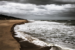 It is Not What it Seems (Graeme O'Rourke) Tags: lrcf2l1916 beach ocean water sea clouds sky storm rain dark sand waves blue green yellow outside nature wet national dunes white light seascape landscape