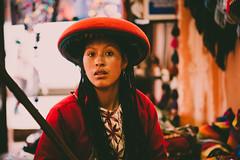 Si la flor a la flor entrega el alto germen (.KiLTЯo.) Tags: kiltro peru chinchero cusco inca quechua people woman tradition history color colour face portrait red natural bestportraitsaoi
