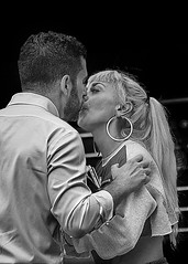 A kiss is just a kiss. (D80_5464629) (Itzick) Tags: manhattansep2019 nyc amanandawoman couple kissing bw blackbackground candid streetphotography emotions d800 itzick