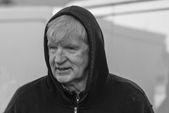Well wrapped up (Frank Fullard) Tags: frankfullard fullard candid street portrait black white blanc noir monochrome cold weather layers older wrappedup face expression castlebar mayo irish ireland nov2019 carbootsale carboot stall stallholder trader hood hoodie hat rugged handsome