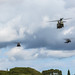 U.S. Army helicopters fly in formation during the 25th Infantry Division Review over Schofield Barracks