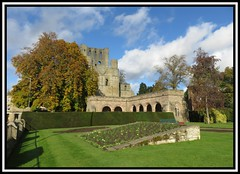 Kelso Abbey (M E For Bees (Was Margaret Edge The Bee Girl)) Tags: abbey kelso scotland ruin old stone christianity green outdoors autumn canon garden trees sun blue sky white clouds arches architecture shadows