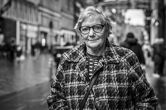 Buchanan Street (Leanne Boulton) Tags: urban street candid portrait portraiture streetphotography candidstreetphotography candidportrait streetportrait eyecontact candideyecontact streetlife old elderly woman female lady face eyes expression emotion mood feeling glasses autumn cold weather poppy tone texture detail depthoffield bokeh naturallight outdoor light shade city scene human life living humanity society culture lifestyle people canon canon5dmkiii 70mm ef2470mmf28liiusm black white blackwhite bw mono blackandwhite monochrome glasgow scotland uk