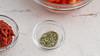 Dried oregano (annick vanderschelden) Tags: oregano herb tomato driedfood dried paste tomatopaste glass bowl cup ingredient garnish food foodpreparation texture flavor belgium