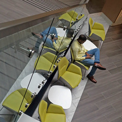 back to back texts (Jim_ATL) Tags: atlanta man reflection chair chartreuse lobby smartphone glass wall stairs diagonal tilt