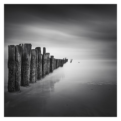 Beyond Time (Marco Maljaars) Tags: longexposure lee filter marcomaljaars seascape sea water le bw blackandwhite monochrome mood canon canon70d 70d ocean netherlands backlight sky reflection beach tide schoorl poles bird pattern
