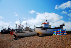 Down on the beach with Hastings Land Based Fishing Fleet (neil mp) Tags: hastings sussex eastsussex coast walk 1066countrywalk beach shingle boats fishingboats sunbathing windbreak rx142 rx52