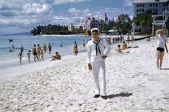 Malihini Sailor Boy at Waikiki 1952 (Kamaaina56) Tags: 1950s waikiki hawaii beach military slide
