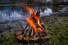 Burning fire on the river bank. (ivan_volchek) Tags: day river bank burning leisure mountain picnic stony summer frowning bonfire fire activities adventure background beach beautiful blaze bright camp campfire close closeup coals cook cookout daylight embers fireplace firewood flame forest green hiking landscape light mountaineering natural nature rock rocky scenery scenic stone sunlight tourism tourist travel vacation wood