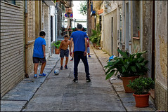 After Work Play   Blanes, Catalonia (Flemming J. Gade) Tags: dad children kids play football street blanes catalonia