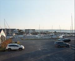 Hotel room view. Port Townsend/Point Hudson (Kent C.) Tags: porttownsend wa pygmyboats mamiyarb67pros film filmphotography kodakportra400 kodakfilm