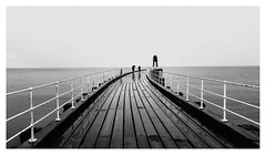 Wet Whitby. (Ian Emerson (Thanks for all the comments and faves) Tags: whitby northyorkshire blackwhite samsung phone wet pier railings curve sea northsea seascape people tourism yorkshire