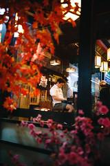 On a sushi bar (Cadicxv8) Tags: restaurant people man dinner flower sakura japanese saigon