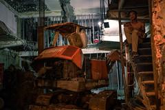On Rubble (Cadicxv8) Tags: construction demoliton ruin worker work night man excavator machine rubble building late dim lone