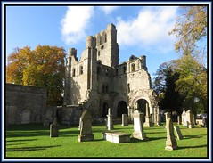 Kelso Abbey. From the graveyard (M E For Bees (Was Margaret Edge The Bee Girl)) Tags: kelso scotland ruin abbey christianity gravestones graveyard green grass autumn canon blue sky white clouds old trees grey brown solitude tranquility peaceful stone architecture building windows arches