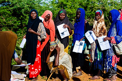 Women wait to receive seeds (FAOemergencies) Tags: fao emergencies somalia africa hornofafrica europeanunion drought seeddistribution inputdistribution farmers agriculture ruralcommunities