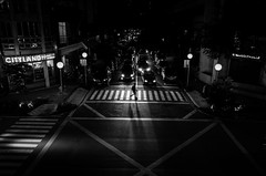 Under the bright lights (Blue Nozomi) Tags: manila makati pedestrian traffic walk crossing street road lane night light black white
