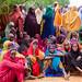 Women wait to receive seeds