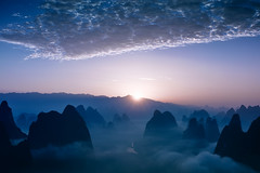Above the clouds. (Fabrizio Massetti) Tags: sunrise sun clouds fog fabriziomassetti famasse landscape landscapes light guilin guangxi guanxi mountain mount liriver iq180 china cambo cina dawn rural river rosso schneider72mm