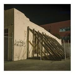 Sagging trapezoid (ADMurr) Tags: la beverly mamiya c330 55mm f45 dbb361a bagel collapse crack brick brooklyn night kodak portra 400