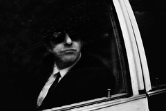 Super Cool (markfly1) Tags: london street candid streetphoto passing car passenger black white mono baw bw tie shades sunglasses cool guy water raindrops reflections vehicle transport abstract nikon d750 35mm manual focus lens