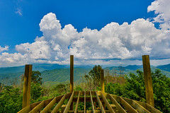 Smokies Overlook (risingthermals) Tags: united states north america usa nc appalachians smoky mountains mountainous terrain hills forms landscapes deck construction wood frame horizon blue clouds sky green trees beams timbers nature outdoors natural summer cumulus billowing deep height elevation