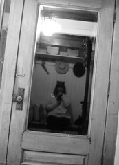 Waiting for Trick or Treaters (rachel.odonnell_3) Tags: halloween blackandwhite night reflection glass door dark light shadow