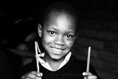 Africa in b/w (Herrmaennchen) Tags: africa tanzania child children people person portrait bw bnw blackandwhite smile happy travel reisen travelphoto travelphotography