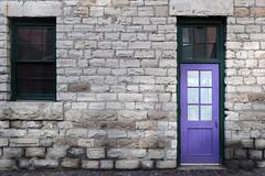 The purple door. (Bernard Spragg) Tags: door entrance brick lumix compactcamera cco