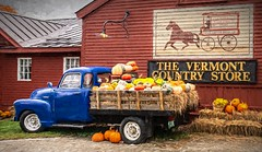 All Decked Out (Wes Iversen) Tags: htt nikkor18300mm truckthursday vermontcountrystore vermontthevermontcountrystore bales flowers mums painterly pickups pumpkins signs squash straw trucks windows